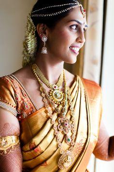 South Indian bride. Temple jewelry. Jhumkis.Gold silk kanchipuram sari.Braid with fresh jasmine flowers. Tamil bride. Telugu bride. Kannada bride. Hindu bride. Malayalee bride.Kerala bride.South Indian wedding