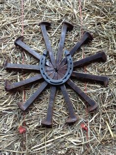 railroad spike crafts | Railroad spike bursting star with horse shoe. Check out American ...