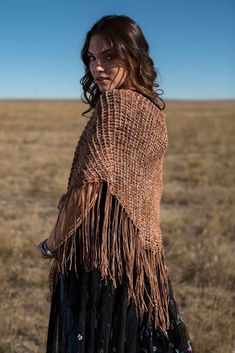 If you're a Tunisian crochet lover who enjoys experimenting with new stitches, you'll want to try the Frontier Shawl. Extended stitches add to the flow and drape, and working from side to side makes this shawl slightly more challenging.