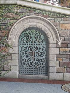"""A detail of the Community Bridge in downtown Frederick. Tromp le oil painted by William Cochran and assistants. """"The Hidden Gate"""", with a key in one of the adjacent bricks."""