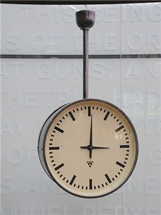 Vintage factory clock. Double sided with modernist faces. Polished steel case. .created by: Elektrocasorigin: Czech Republic--1950.