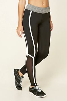 A pair of stretch-knit athletic leggings featuring contrast piping, side mesh panels, moisture management, and a hidden key pocket.