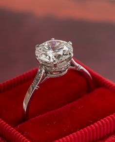 The Queens Park vintage engagement ring features a 2.02ct Round Brilliant Cut diamond set high in a diamond studded basket. Wow!!