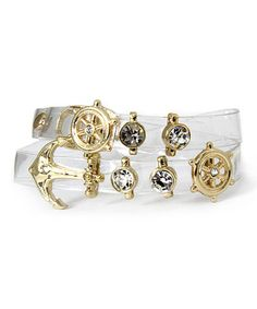 This Rhinestone & Goldtone Nautical Wrap Bracelet by MOA Collection is perfect! Gleaming with rhinestones and goldtone accents, this clear bracelet wraps twice around the wrist for a double dose of seafaring style.   0.3'' W x 14'' L Snap closure Vinyl / zinc / glass Imported  nautical beach beachy sea ocean water marine boat boats ship bling vegan cruelty free