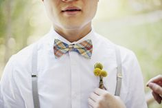 Man in Pink | Braces, plaid bow tie, flower