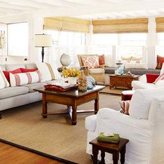 Living Room Arranging Tips For face-to-face chats, place chairs no more than 8 feet apart. In a large living room, use furniture to create comfortable islands. Face two sofas in the center of a room, and place a group chairs and side tables at one end to create a separate conversation area. I like the coastal color scheme plus red.