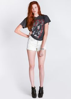 """White high waisted denim shorts featuring distressed front, 5-pocket design, and cut off hem.    By Somedays Lovin  100% Cotton  11"""" length  Model is wearing size XS"""