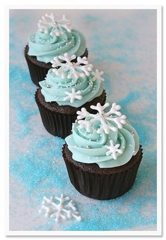 Okay, so I like the chocolate cake and the blue frosting, but add orange sprinkles? No snowflakes.