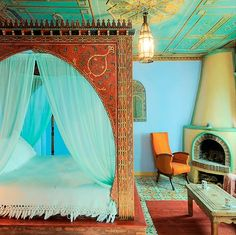 Really gorgeous in it's own way, odd how the light bright blue wall sets the room aglow brightening the otherwise cooler turquoise shade, but the sheers, a more blending hue with ceiling, and a huge bed blocking most of the wall hide the obvious clash allowing the glow be the focal. #home #decor