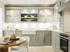 This exquisite chicory painted kitchen features stunning glass fronted cabinetry perfect for all your kitchen storage needs. Large Kitchen Sinks, Small Kitchen Cabinets, Painting Kitchen Cabinets, Kitchen On A Budget, Kitchen Paint, Home Decor Kitchen, Interior Design Kitchen, New Kitchen, Home Kitchens