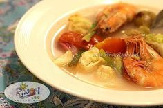 Filipino Shrimp Sinigang with Cabbage is a soup whose flavor is soured with batuan fruits which is abundant in the Western Visayas region of the Philippines. I like the subtle sourness of the batuan. It is a good replacement to the classic sampaloc broth. Read more: http://www.pinoyrecipe.net/filipino-recipe-shrimp-sinigang-with-cabbage/