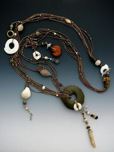 Assortment of antique stone and shells, antique French brass seed beads and silver...  LuciaAntonelli.com