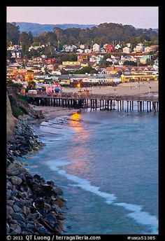 Fishing Pier and village at dusk. Capitola, California, My Moms house is one of the beauitful painted lady Victorians that looks over the village. Beautiful place to see the sunset here.