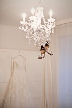#WeddingDress and dancing shoes hanging down from the crystal chandelier #Hochzeitskleid #Pronovias #Alcanar  © www.finestweddingphotography.com Susi Nagele Hochzeitsfotografie | Finest wedding photographer Austria | Vienna  Hochzeitsfotograf Wien Hochzeit Österreich