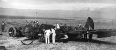 RAF technicians dismantle the Jumo 211B1 engines of Ju 88A-1 B3+DC of Stab 2/KG54 at Blacknore Fort, Portland Head, 2 days after the bomber was claimed by F/O James M Strickland of No 213 Squadron RAF, whilst flying Hurricane Mk I AK-F over Portland Bill at 10.25 on 11 August 1940 following an attack on the nearby naval base. The pilot, Obltn Karl Wette, was badly wounded and captured with his crew.