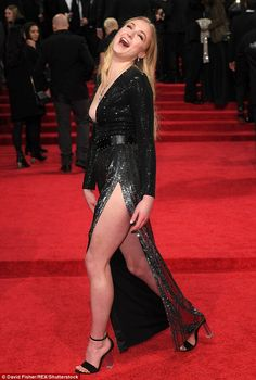 In great spirits: She beamed as she made her way across the carpet in her towering heels...