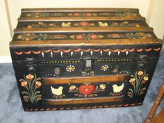 Very old metal and wooden steamer trunk, toll painted in 1978.