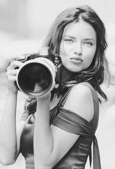 Adriana Lima with a Canon.