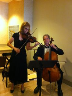 Violin and Cello, a beautiful, choice for a string wedding idea! Here they are performing wedding ceremony for cocktails.