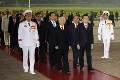 Vietnam's Communist Party (VCP) Secretary General Nguyen Phu Trong, center in gray hair, Prime Minister Nguyen Tan Dung, behind Trong, President Truong Tan Sang, front row right, National Assembly Chairman Nguyen Sinh Hung, behind Tan Sang, and others walk together during a wreath laying ceremony at the mausoleum of the late Vietnamese President Ho Chi Minh prior to the 12th National Congress of the VCP in Hanoi, Vietnam, Wednesday, Jan. 20, 2016. The VCP's 12th congress, which runs ...