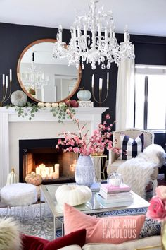 STUNNING & BEAUTIFULLY DECORATED FOR FALL, THIS ROOM. WITH ITS' BLACK WALLS, WHITE FIREPLACE, GORGEOUS MIX OF CUSHIONS, FABULOUS POPS OF PINK & SUPERB SOFA, LOOKS JUST GORGEOUS!#️⃣