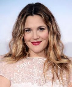 Drew Barrymore is no stranger to hair transformations. Pixie cut, long and straight, fiery red, chin-grazing bob — name a cut or color and she's probably tried it. But, despite all of the coiff changes she goes through, there's one particular style she always goes back to: beachy waves. Now,