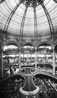Under the Neo-byzantine glass dome of the Haussmann store, designed by master glass maker Jacques Gruber in 1912.