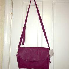 Liz Claiborne plum purse Beautiful purse. New with tag. The color is amazing. Had lots of pockets and it's very spacious Liz Claiborne Bags
