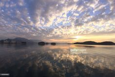 Scenic View Of Sea With Reflection During Sunrise