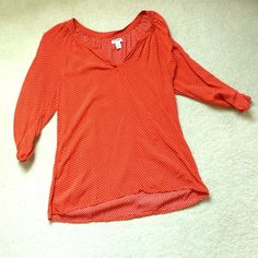 Top Orange 3/4sleeve top with black design. In excellent condition. Old Navy Tops Blouses