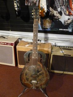 1937 National Triolian resonator guitarI I HAVE ONE OF THESE BUT INSTEAD OF METAL, IT'S ALL WOOD.  ANYONE WANNA BUY IT?