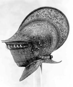Burgonet with Buffe  Date:ca. 1555–60Culture:ItalianMedium:Steel, etched and giltDimensions:Weight, 6 lb. 6 oz. (2892 g) Height, 13 3/4 in. (34.93 cm) Height of comb, 3 in. (7.62 cm) Greatest depth, 15 in. (38.1 cm)Classification:HelmetsCredit Line:Gift of William H. Riggs, 1913Accession Number:14.25.613  http://www.metmuseum.org/Collections/search-the-collections/40000432?rpp=60=1=371=*=43
