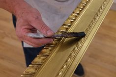 Our master framer Antonio putting the finishing touches to a hand-carved, water-gilded frame.