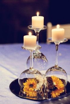 I love this idea of putting a candle on the base of a wineglass. Very chic.
