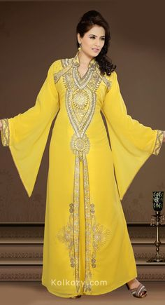 Shop #popular #Kaftan in yellow color faux georgette. Amazing embroidery word with hand bead.