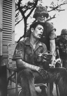 LIFE photographer Co Rentmeester (seated) wounded  in a firefight, 1968. Photographed by John Olson.