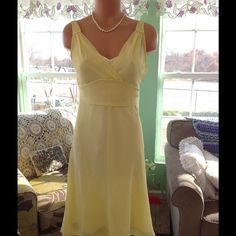 Beautiful Express Dress This is a very pretty dress, it is 100% Silk. The lining is 100% Polyester .. It so soft and smooth and looks really expensive. Only wore once to a wedding. Express Dresses Midi