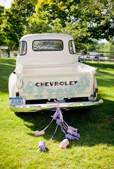 "Brides.com: . The bride and groom adorned their white Chevy pickup truck with a playful ""Hitched"" banner. Complete with painted tin cans, it's the…"