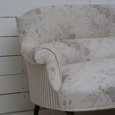 Antique French Sofa re-upholstered using complimentary Kate Forman fabrics 'Oyster Roses' on the front and 'Charcoal Stripe' on the back