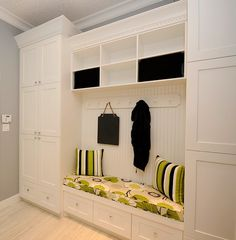 Like the cushioned sitting area and some closed closet/cabinet space