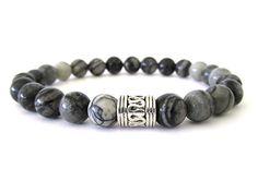 ery cool and hip men's bracelet with 8mm black silk stone beads and a pewter focal bead. Black silk stone is an onyx marble offering a striking contrast of black and white.