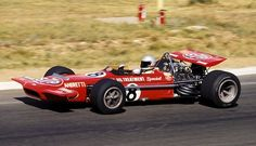 The STP corporation entered a March 701 for Mario Andretti (USA), but the Cosworth engine that powered it overheated on lap 27 - sending Andretti out of the race. Indy Car Racing, Indy Cars, Aston Martin, Formula 1, Mario Andretti, American Racing, Old Race Cars, Race Engines, Automotive Art