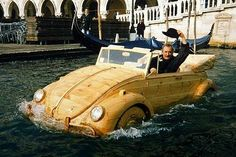 De Marchi's floating, swimming, wooden VW Beetle, with the artist grinning puckishly behind the wheel as he cruises around the canals of Venice.