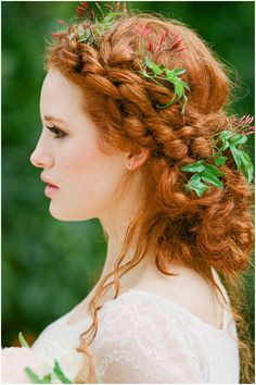 messy updo for copper hair  Solid intense auburn hair hue works fantastic for naturally curly hair in eco-inspired hairstyles. I love this intricate messy braided downdo with simple natural adornments, intensifying the copper notes of the hair.