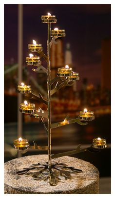 O, Christmas tree! You don't have to sacrifice chic style to bring seasonal decor into your space. Find your Silver Snowflake Tealight Tree Centerpiece at PartyLite.com.