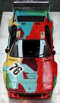 BMW M1 car painted by Andy Warhol in 1979. He spent only a total of 23 minutes to paint the entire car.