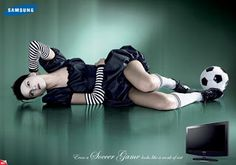 This advertisement also uses sexuality as its main selling point. It shows a woman with a soccer ball near her feet and Samsung wants the consumer to feel like their monitor has the best quality and by using a beautiful lady dressed in black in front of a green background, it definitely does that. I find it interesting  how small the television at the bottom is compared to the woman who is laying across the entire advertisement.