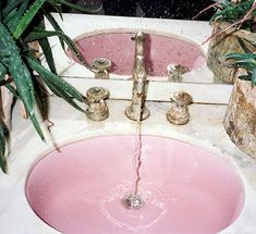 Pink sink, marble counter!!! Bebe'!!! Love the pink!!!