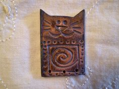 Jennifer Hanson - Ceramic artist.  Raku Bead, Cat Bead, Spiral Pattern, Handmade Ceramic Jewelry Supply, Focal Beads. $6.00, via Etsy.