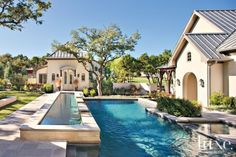 Transitional Cream Exterior with Limestone Hardscaping Country Pool, Austin Homes, Austin Tx, French Country Style, Pool Houses, Maine House, Pool Designs, Exterior Design, Outdoor Living